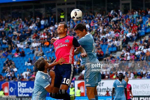 PierreMichel Lasogga of Hamburg challenges Philipp Wollscheid of Stoke City during the preseason friendly match between Hamburger SV and Stoke City...