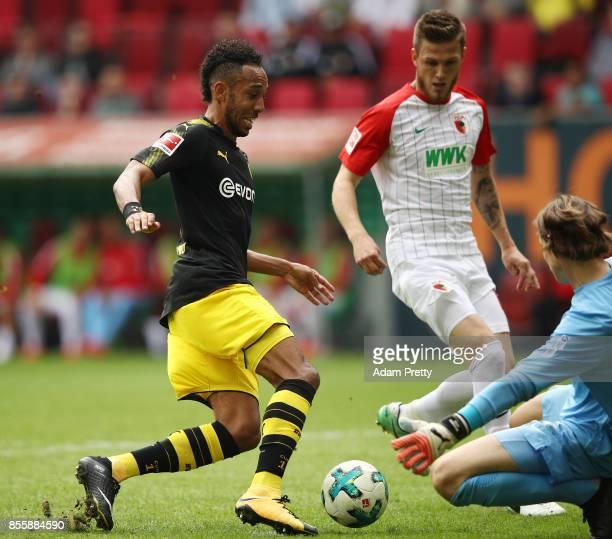 PierreMichel Lasogga of Hamburg is saved by goalkeeper Marwin Hitz of Augsburg during the Bundesliga match between FC Augsburg and Borussia Dortmund...
