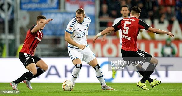 PierreMichel Lasogga of Hamburg Mathew Leckie of Ingolstadt and #i5i tussle for the ball during the Bundesliga match between FC Ingolstadt and...