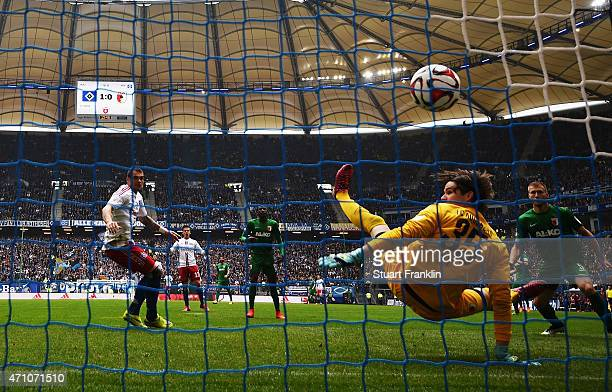 PierreMichel Lasogga of Hamburg scores his goal during the Bundeslga match between Hamburger SV and FC Augsburg at Imtech Arena on April 25 2015 in...