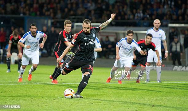 PierreMichel Lasogga of Hamburger SV scores the first goal for his team with a penalty during the first bundesliga match between SV Darmstadt 98 and...