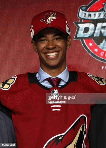 PierreOlivier Joseph poses onstage after being selected 23rd overall by the Arizona Coyotes during Round One of the 2017 NHL Draft at United Center...