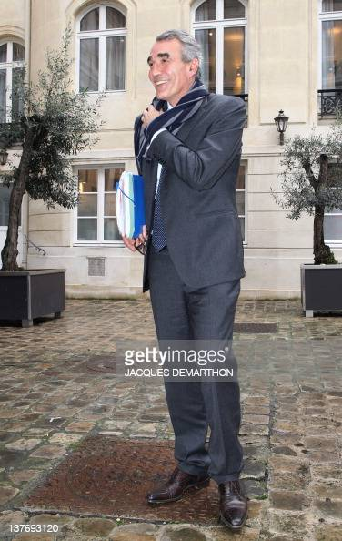 PierreYves Revol the chairman of the Ligue nationale de Rugby smiles as he leaves after the hearing of Toulon rugby union club president Mourad...