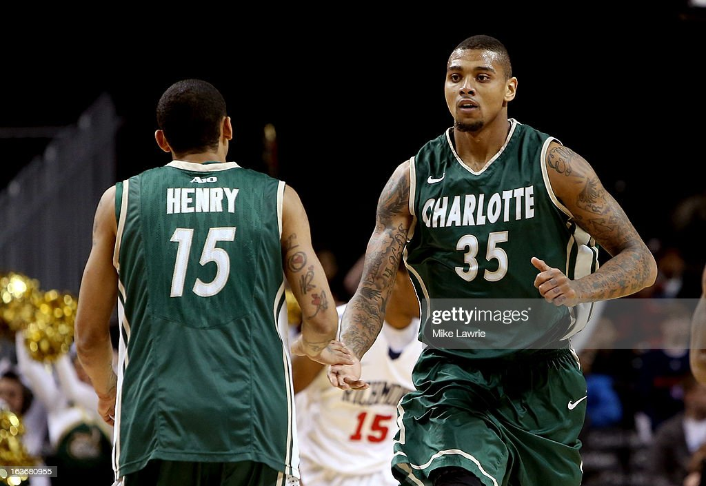 Pierria Henry #15 and Chris Braswell #35 of the Charlotte 49ers celebrate after a basket in the second half against the Richmond Spiders during the first round of the Atlantic 10 basketball tournament at Barclays Center on March 14, 2013 in New York City.