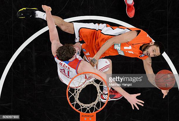 Pierria Henry of Ulm is challenged by Daniel Mayr of FC Bayern Muenchen during the Eurocup Basketball match between ratiopharm Ulm and FC Bayern...