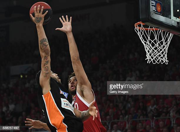 Pierria Henry shoots agains Elias Harris during the BEKO BBL Final game 1 between Brose Baskets Bamberg and ratipopharm Ulm at Brose Arena on June 5...