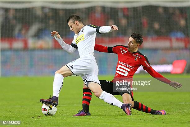 Pierrick Capelle of Angers and Adrien Hunou of Rennes during the Ligue 1 match between Stade Rennais and Sco Angers at Stade de la Route de Lorient...