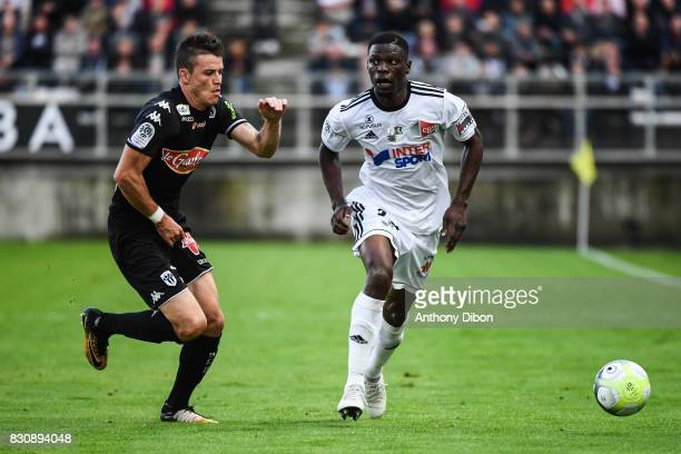 Pierrick Capelle of Angers and Bakaye Dibassy of Amiens during the Ligue 1 match between Amiens SC and Angers SCO at Stade de la Licorne on August 12...