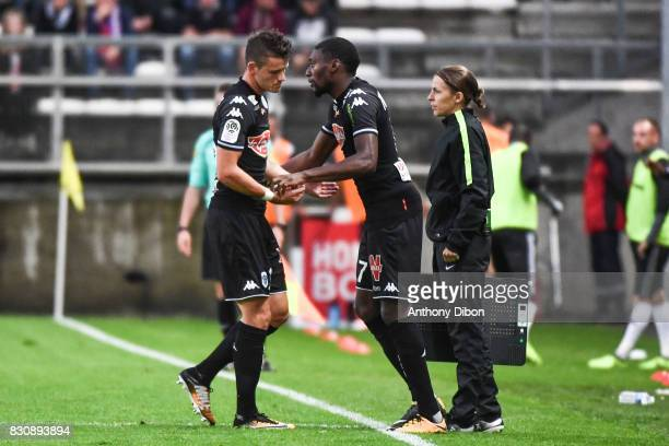 Pierrick Capelle of Angers is replaced by Karl TOko Ekambi of Angers during the Ligue 1 match between Amiens SC and Angers SCO at Stade de la Licorne...