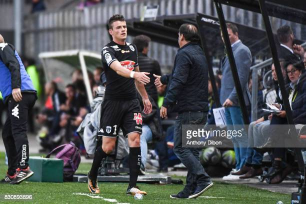 Pierrick Capelle of Angers shakes hand with Stephane Moulin coach of Angers during the Ligue 1 match between Amiens SC and Angers SCO at Stade de la...