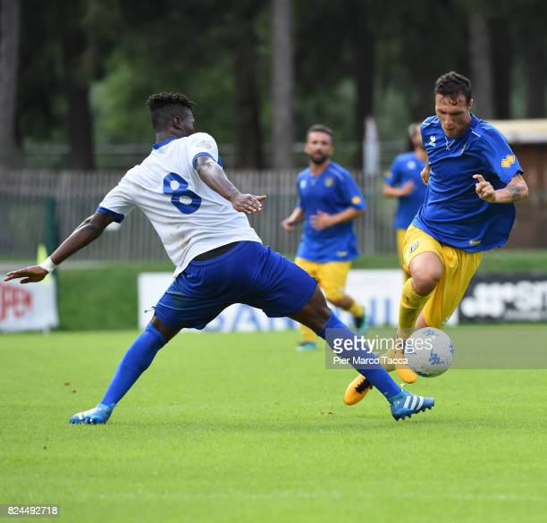 Pierrot Karamoku of Dro competes for the ball with Luca Siligardi of Parma Calcio during the preseason friendly match between Parma Calcio and Dro on...