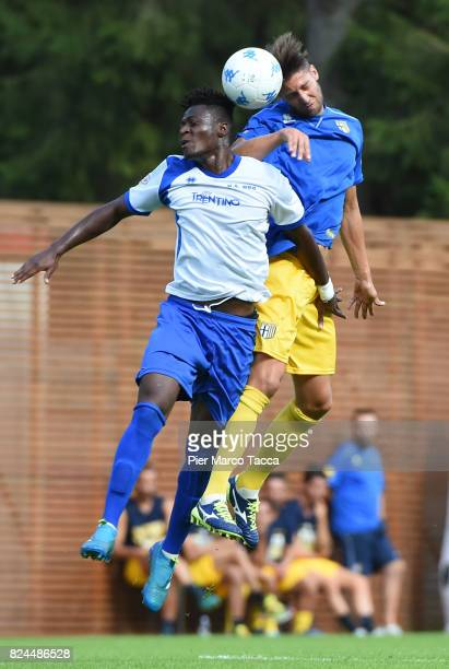 Pierrot Karamoku of Dro competes for the ball with Manuel Scavone of Parma Calcio during the preseason friendly match between Parma Calcio and Dro on...