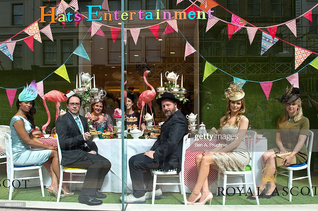 Piers Atkinson, Vivien Sheriff, Rosie Olivia, Noel Stewart and Jane Taylor pose for a photograph ahead of Royal Ascot which takes place from June 17th-21st, leading London department store Fenwick of Bond Street launches its Mad Hatters window which celebrates the exciting and talented milliners sold at Fenwick - including Jane Taylor, Piers Atkinson, Noel Stewart, Rosie Olivia and Vivien Sheriff at Fenwick Of Bond Street on May 6, 2014 in London, England.