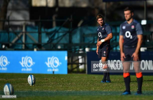 Piers Francis of England looks on as George Ford of England lines up a kick at goal during a training session at San Isidro Club on June 14 2017 in...