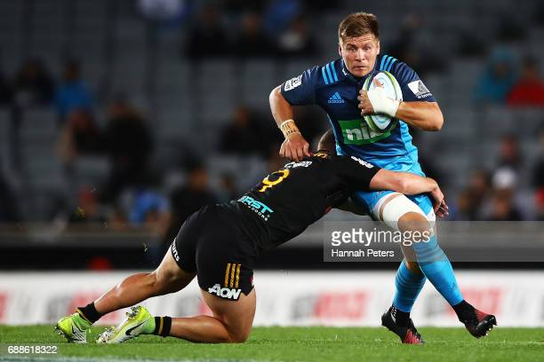 Piers Francis of the Blues charges forward during the round 14 Super Rugby match between the Blues and the Chiefs and Eden Park on May 26 2017 in...