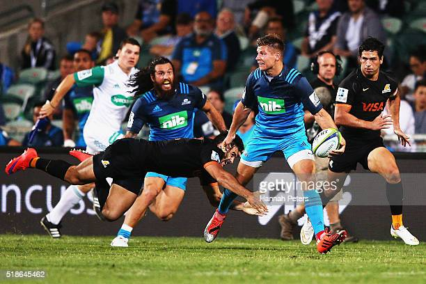 Piers Francis of the Blues makes a break during the round 6 super rugby match between the Blues and the Jaguares at QBE Stadium on April 2 2016 in...