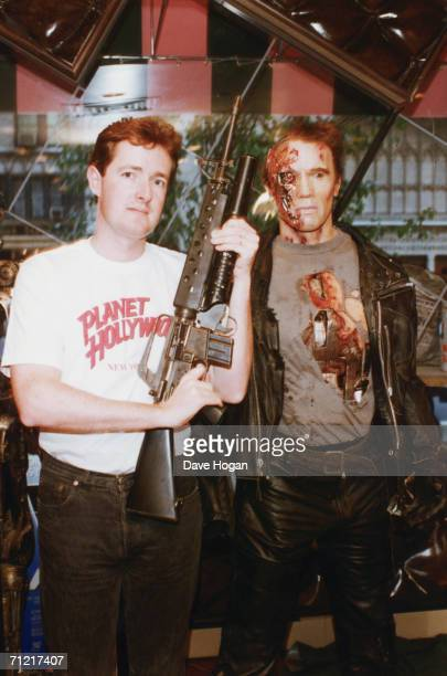 Piers Morgan editor of the Daily Mirror poses in a Planet Hollywood tshirt next to a waxwork of Arnold Schwarzenegger in 'Terminator 2 Judgment Day'...