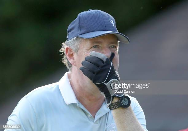 Piers Morgan of England the television personlity reacts to a shot during the proam for the 2017 BMW PGA Championship on the West Course at Wentworth...
