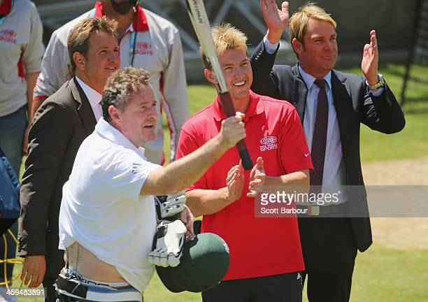 Piers Morgan salutes the crowd after facing deliveries from former Australian cricketer Brett Lee as commentator Mark Nicholas and Shane Warne look...