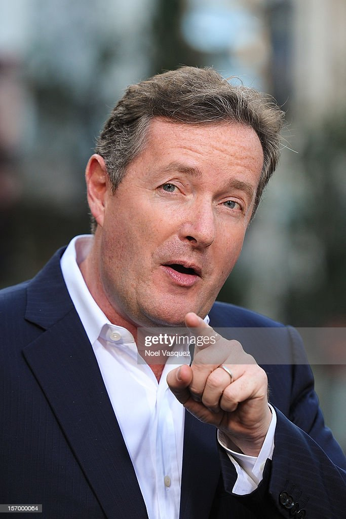 <a gi-track='captionPersonalityLinkClicked' href=/galleries/search?phrase=Piers+Morgan&family=editorial&specificpeople=216509 ng-click='$event.stopPropagation()'>Piers Morgan</a> visits 'Extra' at The Grove on November 26, 2012 in Los Angeles, California.