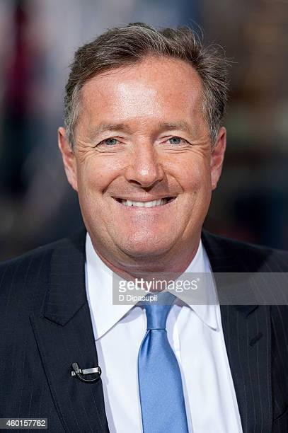Piers Morgan visits 'Extra' at their New York studios at HM in Times Square on December 8 2014 in New York City