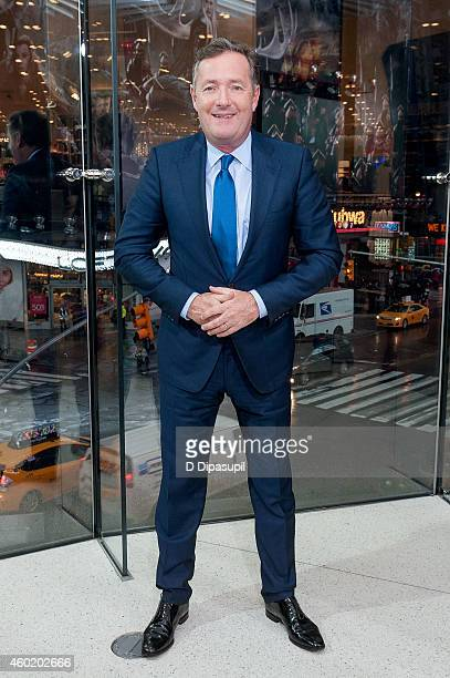 Piers Morgan visits 'Extra' at their New York studios at HM in Times Square on December 9 2014 in New York City
