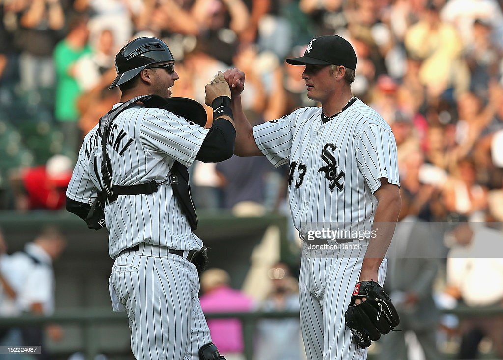<a gi-track='captionPersonalityLinkClicked' href=/galleries/search?phrase=A.J.+Pierzynski&family=editorial&specificpeople=204486 ng-click='$event.stopPropagation()'>A.J. Pierzynski</a> #12 and Addison Reed #43 of the Chicago White Sox celebrate a win against the Detroit Tigers at U.S. Cellular Field on September 17, 2012 in Chicago, Illinois. The White Sox defeated the Tigers 5-4.