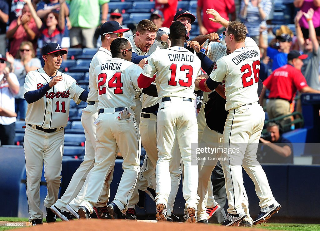 A J Pierzynski of the Atlanta Braves is mobbed by teammates after knocking in the gamewinning run with a ninth inning single against the Philadelphia...