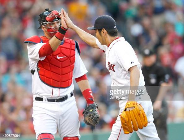 J Pierzynski of the Boston Red Sox and Koji Uehara celebrate after a scoreless ninth inning against the Cleveland Indians at Fenway Park on June 14...