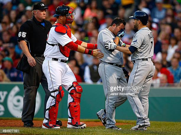 J Pierzynski of the Boston Red Sox walks Ali Solis of the Tampa Bay Rays towards his teammate David DeJesus after being hit with a bounced ball in...
