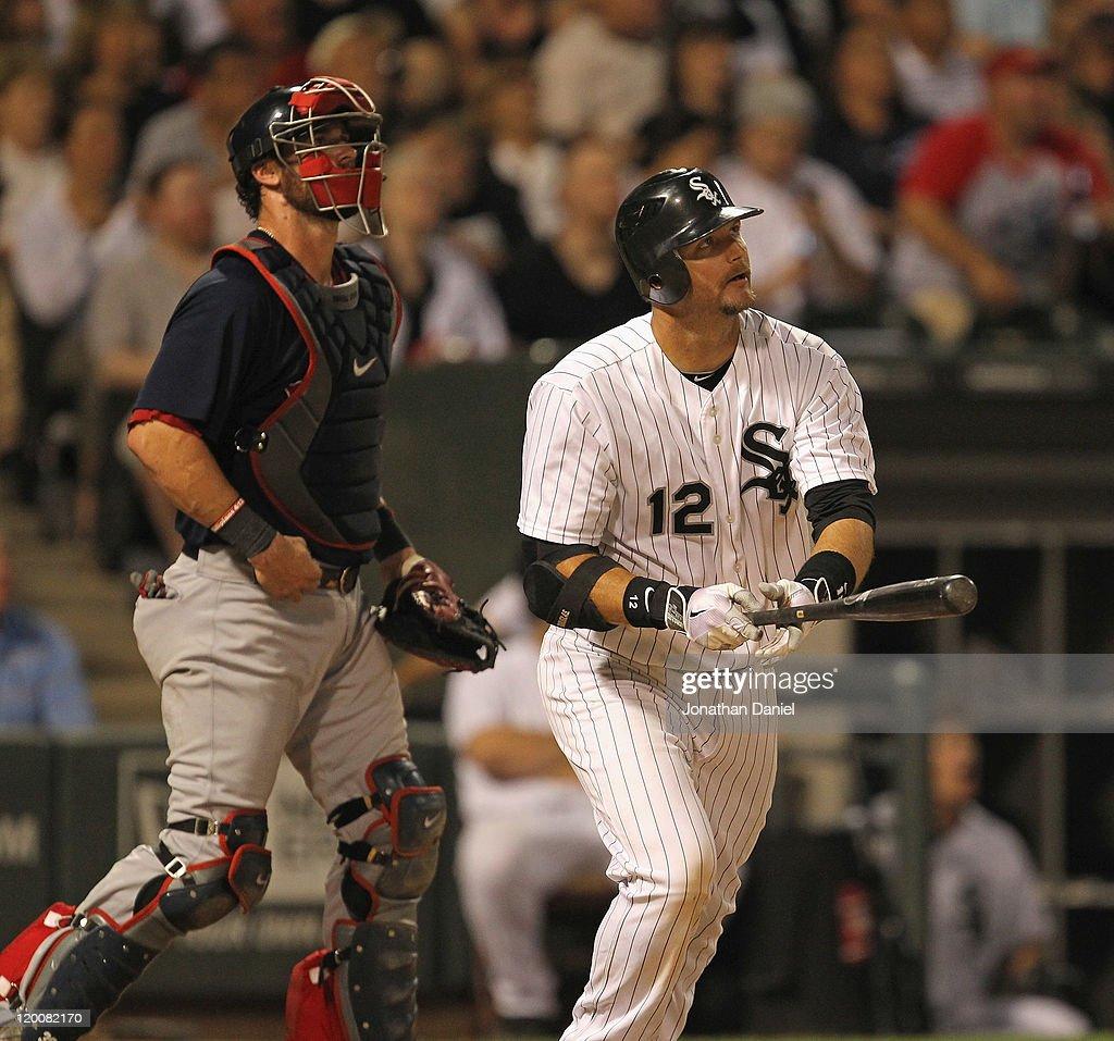 J Pierzynski of the Chicago White Sox and Jarrod Saltalamacchia of the Boston Red Sox follow the flight of Pierzynski's tworun home run in the 7th...