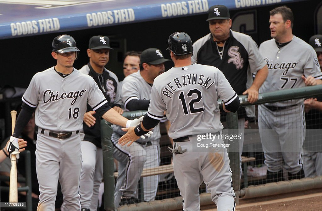 <a gi-track='captionPersonalityLinkClicked' href=/galleries/search?phrase=A.J.+Pierzynski&family=editorial&specificpeople=204486 ng-click='$event.stopPropagation()'>A.J. Pierzynski</a> #12 of the Chicago White Sox heads to the dugout after he scored to tie the game 4-4 with the Colorado Rockies in a sacrifice fly by Juan Pierre #1 of the White Sox in the eighth inning during Interleague play at Coors Field on June 30, 2011 in Denver, Colorado. Pierzynski scored the winning run in the 10th inning as the White Sox defeated the Rockies 6-4.