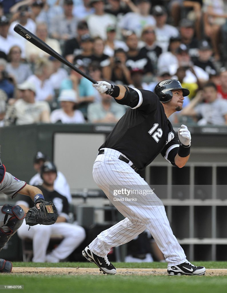 A.J. Pierzynski #12 of the Chicago White Sox hits a double in the ninth inning against the Minnesota Twins on July 9, 2011 at U.S. Cellular Field in Chicago, Illinois. The White Sox defeated the Twins 4-3.