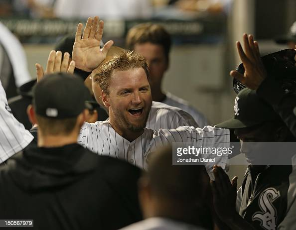 J Pierzynski of the Chicago White Sox is congratulated in the dugout by teammates after scoring a run in the 8th inning against the New York Yankees...