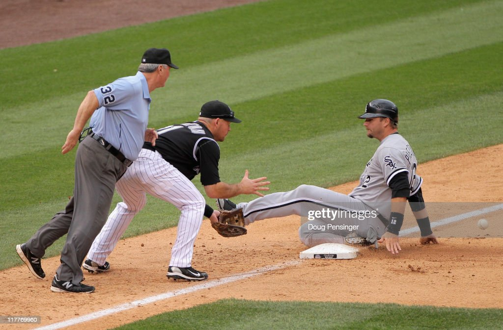 <a gi-track='captionPersonalityLinkClicked' href=/galleries/search?phrase=A.J.+Pierzynski&family=editorial&specificpeople=204486 ng-click='$event.stopPropagation()'>A.J. Pierzynski</a> #12 of the Chicago White Sox slides safely into third base as third baseman <a gi-track='captionPersonalityLinkClicked' href=/galleries/search?phrase=Ty+Wigginton&family=editorial&specificpeople=211533 ng-click='$event.stopPropagation()'>Ty Wigginton</a> #21 of the Colorado Rockies takes the late throw and umpire Dana DeMuth oversees the action as Pierzynski advanced on a single by Gordon Beckham of the White Sox in the eighth inning during Interleague play at Coors Field on June 30, 2011 in Denver, Colorado. The White Sox defeated the Rockies 6-4 in 10 innings.