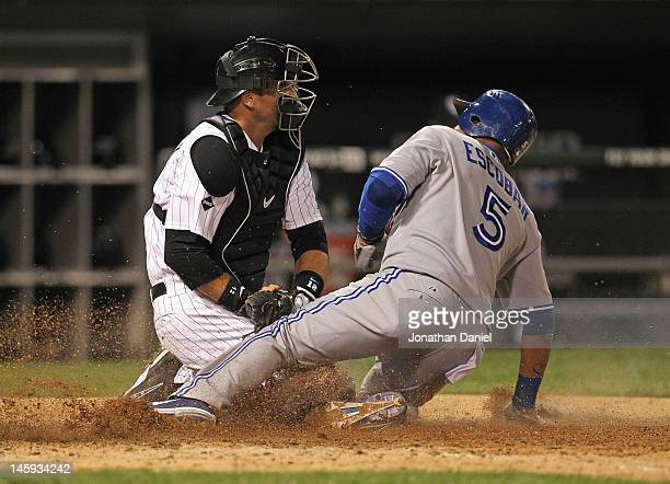 J Pierzynski of the Chicago White Sox tags out Yunel Escobar of the Toronto Blue Jays to end the top of the 9th inning at US Cellular Field on June 7...