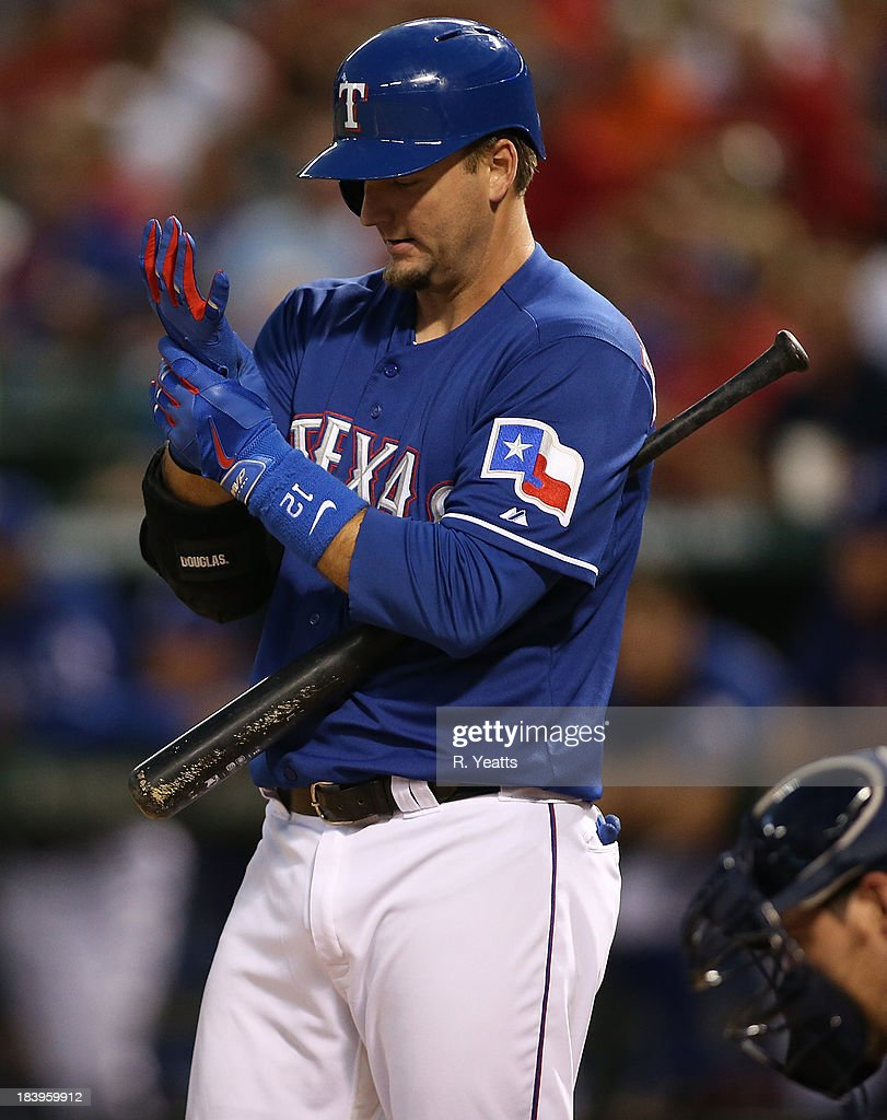 A.J. Pierzynski #12 of the Texas Rangers adjust his batting gloves before hitting against the Houston Astros in the second inning at Rangers Ballpark in Arlington on September 25, 2013 in Arlington, Texas.
