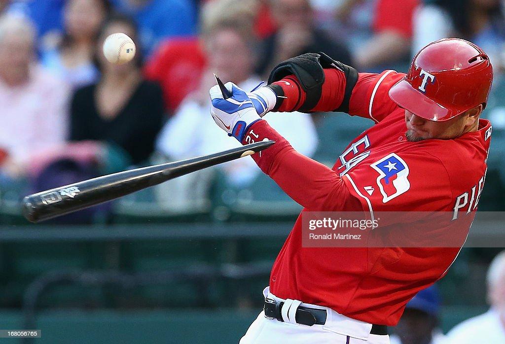 A.J. Pierzynski #12 of the Texas Rangers breaks his bat against the Boston Red Sox at Rangers Ballpark in Arlington on May 4, 2013 in Arlington, Texas.