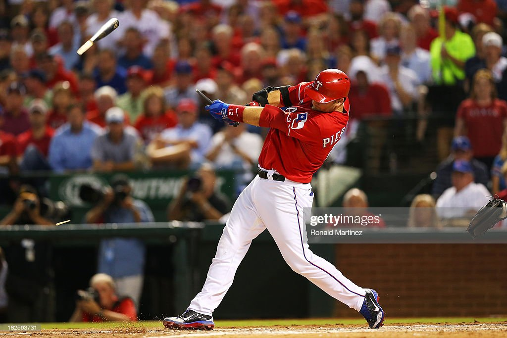 A.J. Pierzynski #12 of the Texas Rangers breaks his bat on a ground out in the sixth inning against the Tampa Bay Rays during the American League Wild Card tiebreaker game at Rangers Ballpark in Arlington on September 30, 2013 in Arlington, Texas.