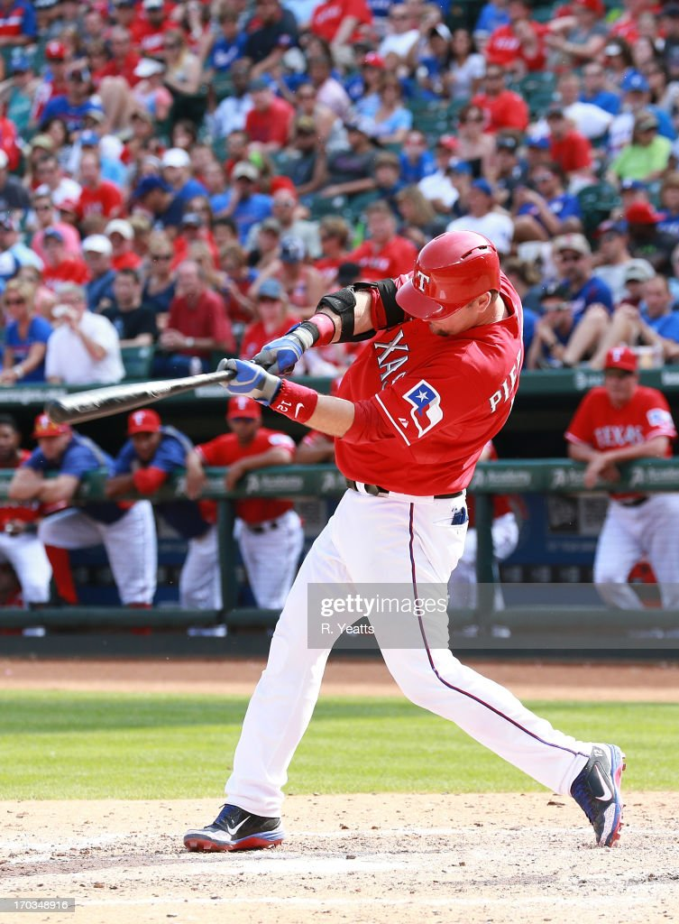 <a gi-track='captionPersonalityLinkClicked' href=/galleries/search?phrase=A.J.+Pierzynski&family=editorial&specificpeople=204486 ng-click='$event.stopPropagation()'>A.J. Pierzynski</a> #12 of the Texas Rangers hits against the Kansas City Royals at Rangers Ballpark in Arlington on June 1, 2013 in Arlington, Texas.