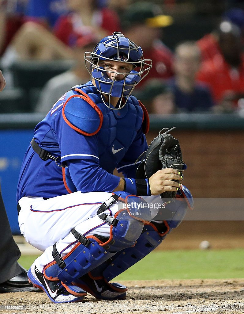A.J. Pierzynski #12 of the Texas Rangers looks for the call from the in the dugout in the sixth inning against the Houston Astros at Rangers Ballpark in Arlington on September 25, 2013 in Arlington, Texas.