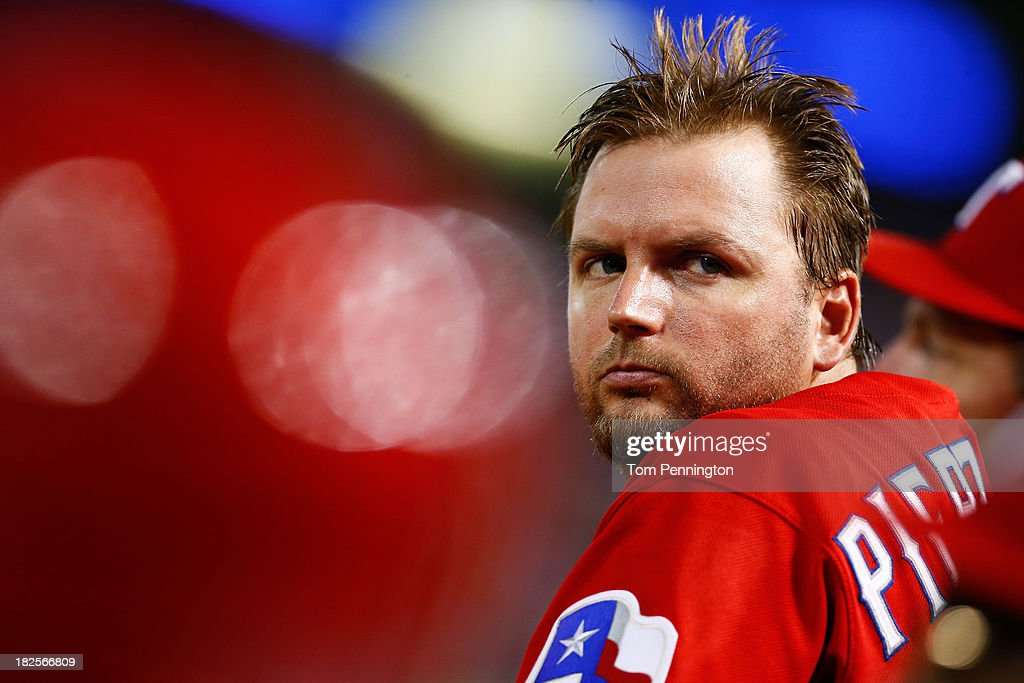 A.J. Pierzynski #12 of the Texas Rangers looks on in the fifth inning against the Tampa Bay Rays during the American League Wild Card tiebreaker game at Rangers Ballpark in Arlington on September 30, 2013 in Arlington, Texas.