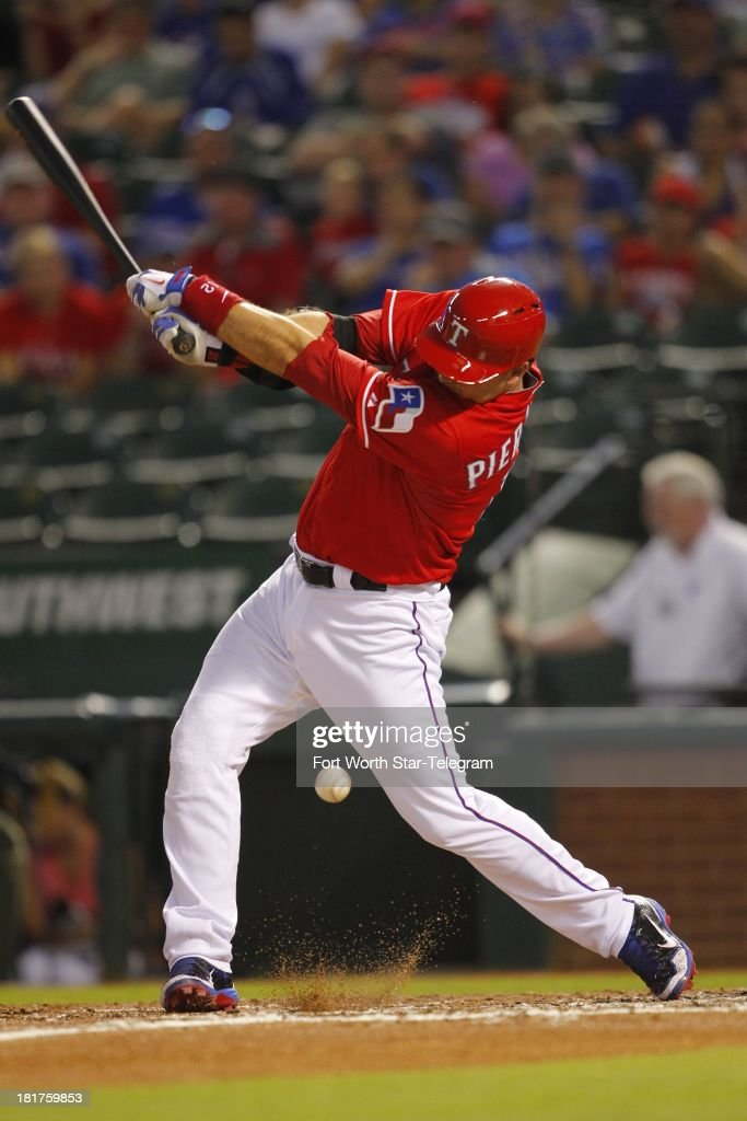 A.J. Pierzynski of the Texas Rangers swings for strike in the second inning against the Houston Astros at Rangers Ballpark in Arlington, Texas, on Tuesday, September 24, 2013.