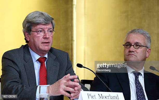 Piet Moerland chairman of Rabobank Groep left speaks as Roderick Munsters chief executive officer of Robeco Groep NV looks on during a news...