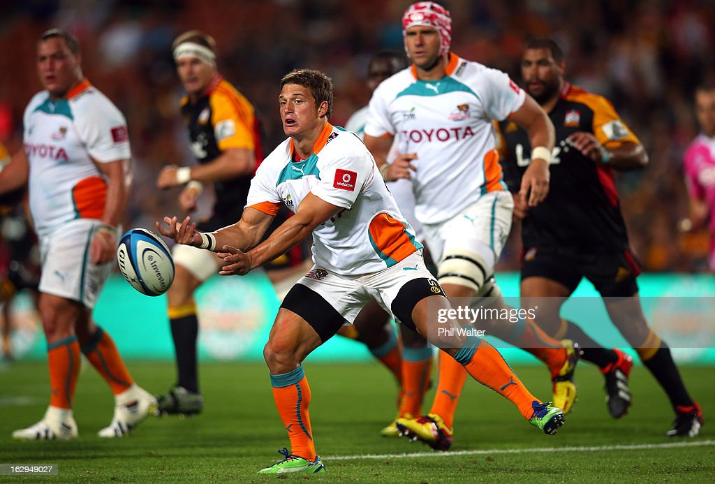 Piet Van Zyl of the Cheetahs offloads the ball during the round three Super Rugby match between the Chiefs and the Cheetahs at Waikato Stadium on March 2, 2013 in Hamilton, New Zealand.
