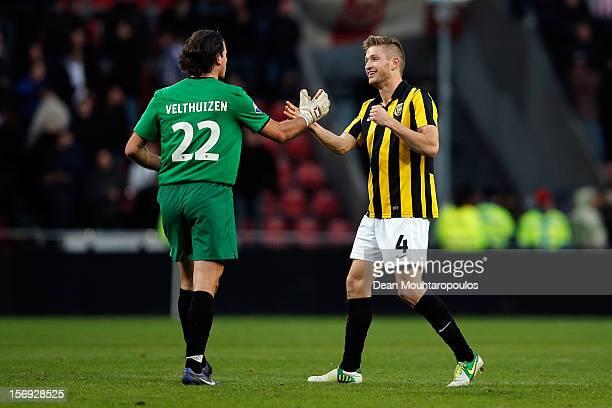 Piet Velthuizen and JanArie Van Der Heijden of Vitesse celebrate victory after the Eredivisie match between PSV Eindhoven and Vitesse Arnhem at...