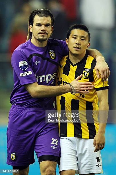 Piet Velthuizen and Michihiro Yasuda of Vitesse thanks the fans after victory in the Eredivisie match between Vitesse Arnhem and SC Heracles Almelo...