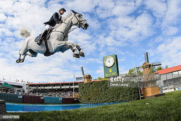 Pieter Devos of Belgium riding Dylano competes in the individual jumping equestrian on the final day of the Masters tournament at Spruce Meadows on...