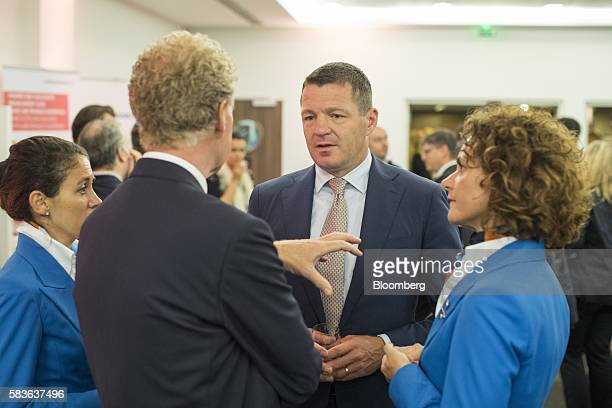Pieter Elbers chief executive officer of KLM division of Air FranceKLM Group center speaks to cabin crew members ahead of a news conference to...