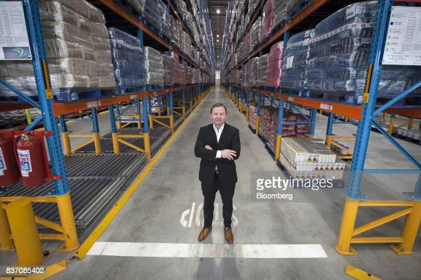 Pieter Engelbrecht chief executive officer of Shoprite Holdings Ltd poses for a photograph in the company's new Cilmore distribution center in Cape...